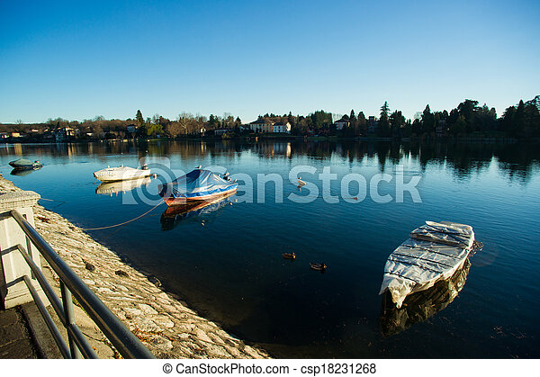 Boats moored on the bank of lake - csp18231268