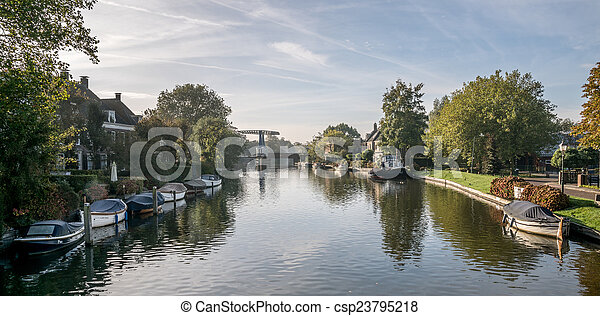 Boats on a quiet river - csp23795218