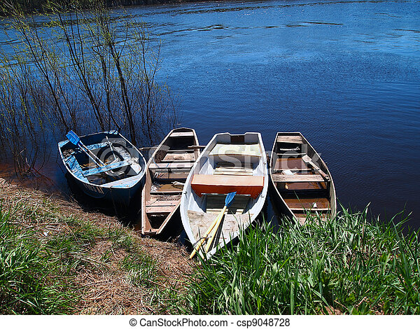 Boats on a shore of a river - csp9048728
