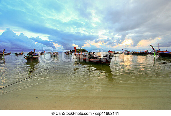 Boats on shore with sunset background, Thailand - csp41682141