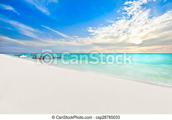 Boats on the beach at sunrise time - csp28765033