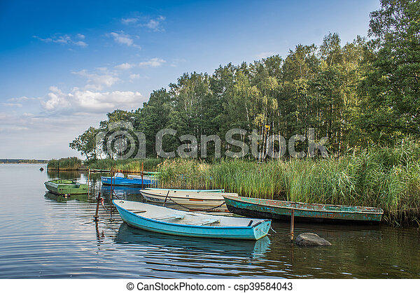 boats on the lake at sunset - csp39584043