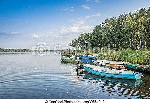 boats on the lake at sunset - csp39584049