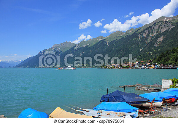 Boats on the shore of Lake Brienz. - csp70975064