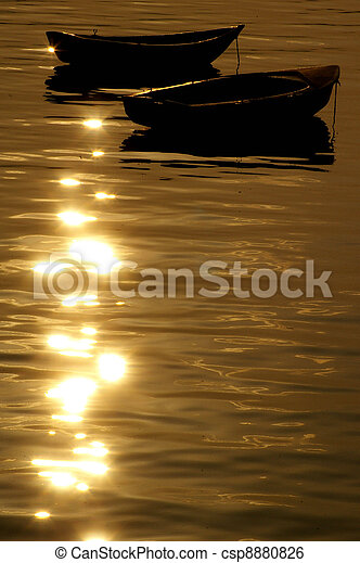 Boats over the ocean at sunset - csp8880826