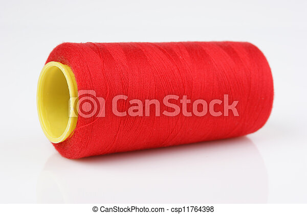 bobbin with red thread on a white background - csp11764398