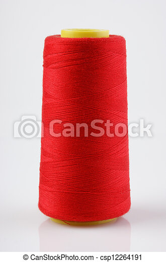 bobbin with red thread on a white background - csp12264191
