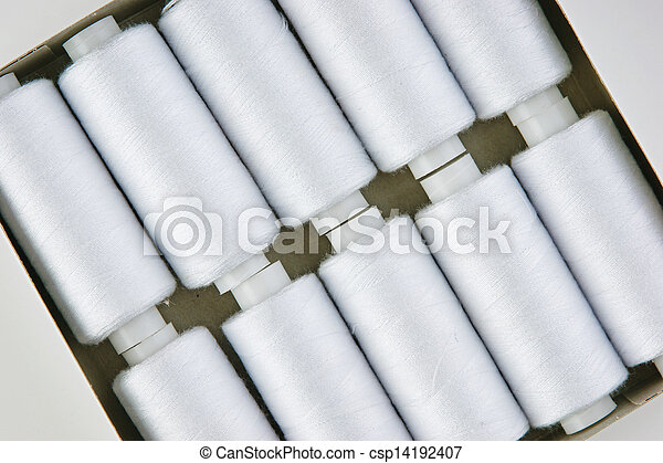 bobbin with white thread on a white background - csp14192407