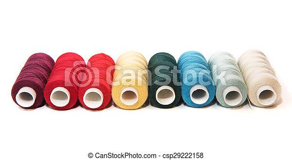 Bobbins of thread on white background - csp29222158