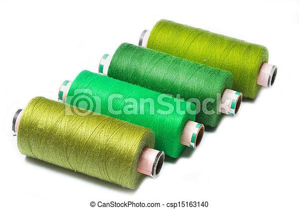 Bobbins of thread on white background - csp15163140