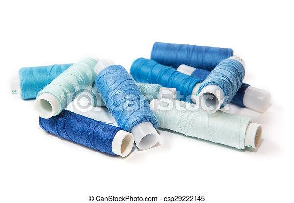 Bobbins of thread on white background - csp29222145