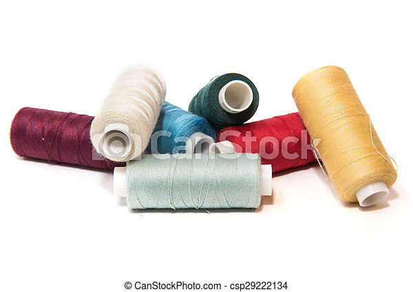 Bobbins of thread on white background - csp29222134