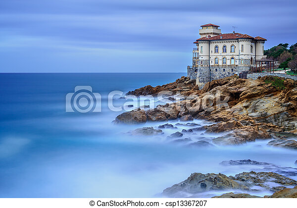Boccale castle landmark on cliff rock and sea. Tuscany, Italy. Long exposure photography. - csp13367207