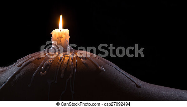 Body scape of a well-shaped woman with burning candle and wax on her bum - csp27092494