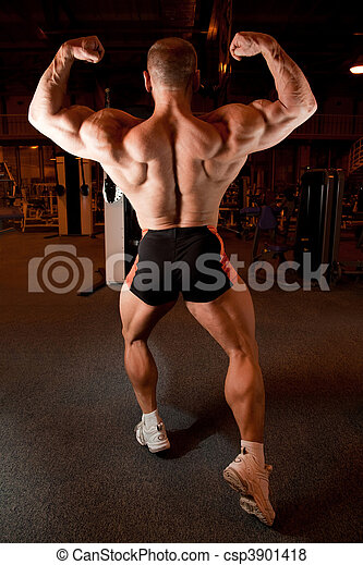 bodybuilder back demonstrates his muscles - csp3901418