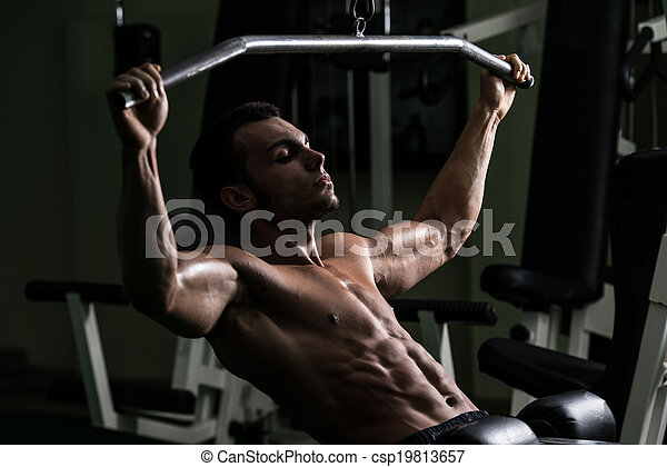 Bodybuilder Doing Heavy Weight Exercise For Back - csp19813657