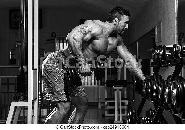 Bodybuilder Doing Heavy Weight Exercise For Back - csp24910604