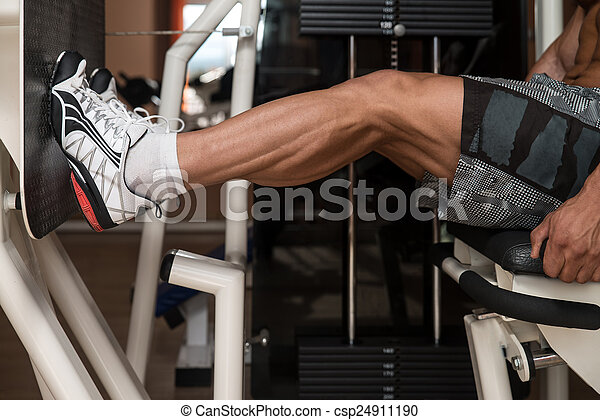 Bodybuilder Doing Legs Exercise - csp24911190