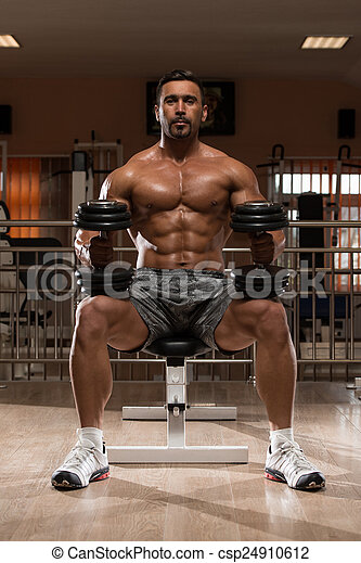 Bodybuilder Exercising Shoulders - csp24910612