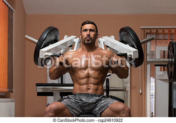 Bodybuilder Exercising Shoulders - csp24910922