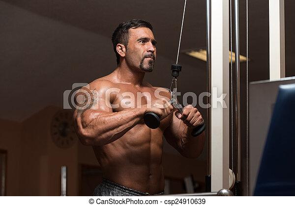 Bodybuilder Exercising Triceps - csp24910639