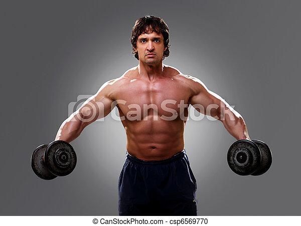 Bodybuilder lifting some weights, closeup - csp6569770
