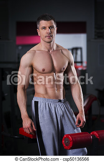 bodybuilder workout in gym perfect muscular male body