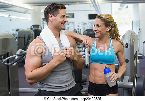 Bodybuilding man and woman chatting together - csp20439525
