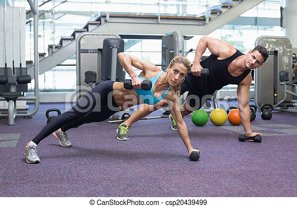 Bodybuilding man and woman holding  - csp20439499