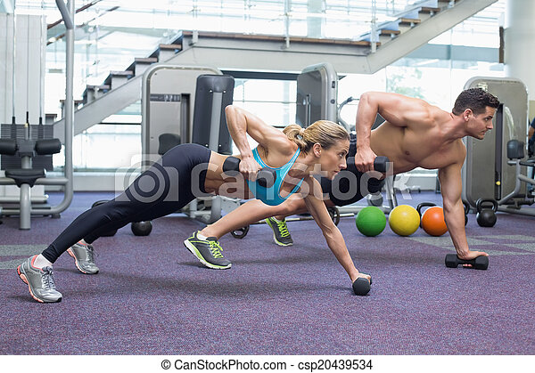 Bodybuilding man and woman holding  - csp20439534