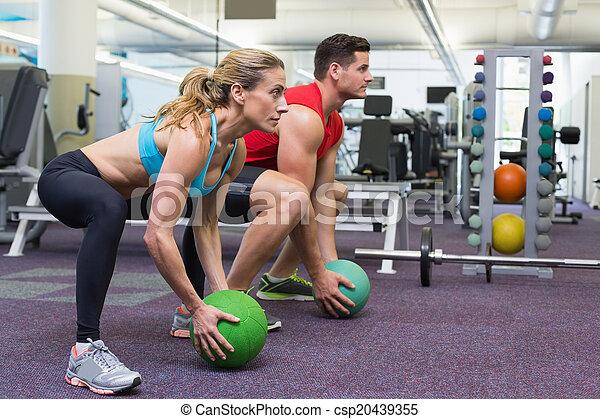 Bodybuilding man and woman lifting  - csp20439355