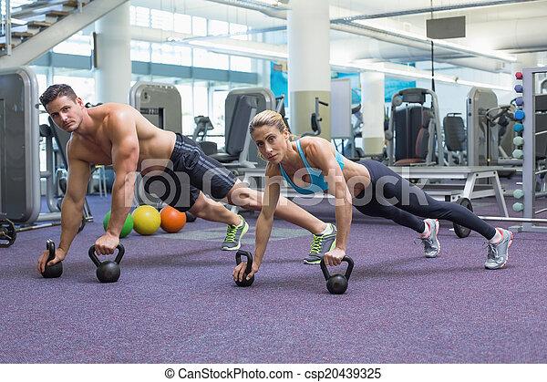 Bodybuilding man and woman lifting  - csp20439325