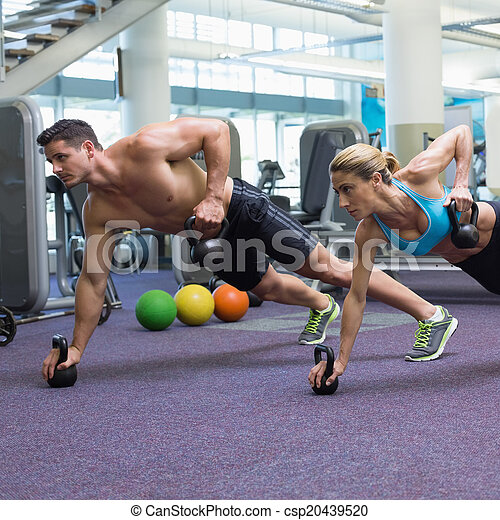 Bodybuilding man and woman lifting  - csp20439520