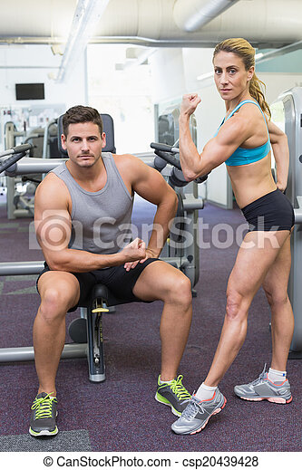 Bodybuilding man and woman posing f - csp20439428