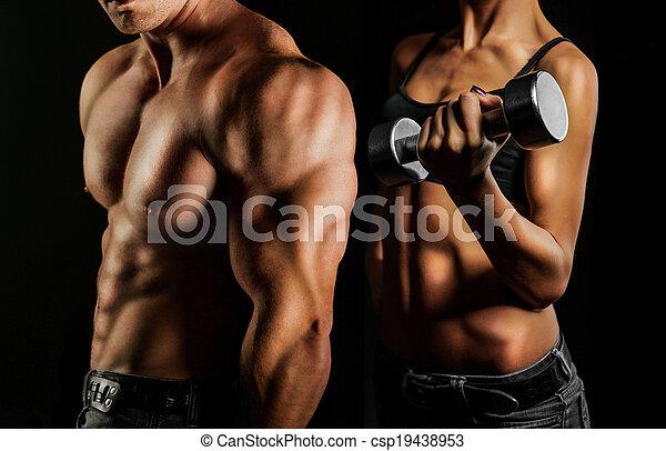 Bodybuilding. Man and  woman - csp19438953