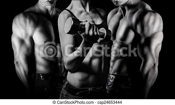 Bodybuilding. Man and  woman - csp24653444