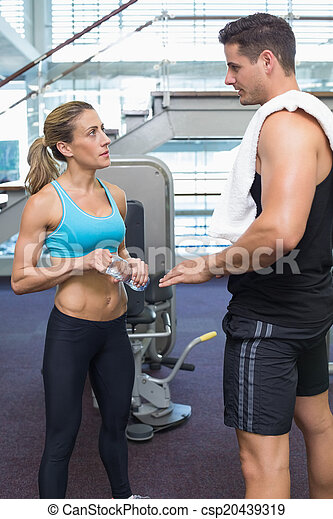 Bodybuilding man and woman talking together - csp20439319