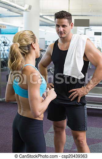 Bodybuilding man and woman talking together - csp20439363