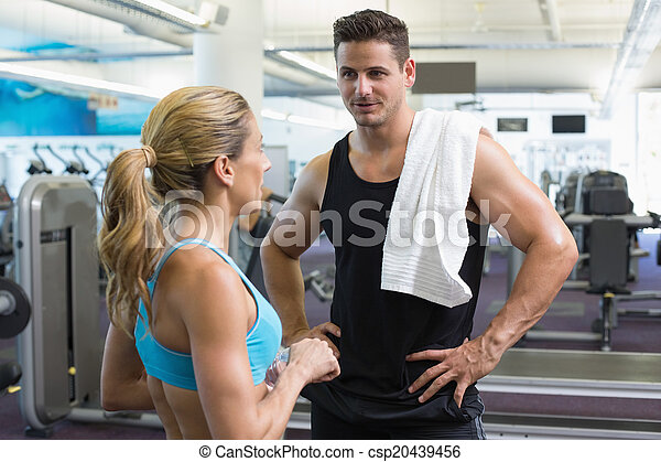 Bodybuilding man and woman talking together - csp20439456