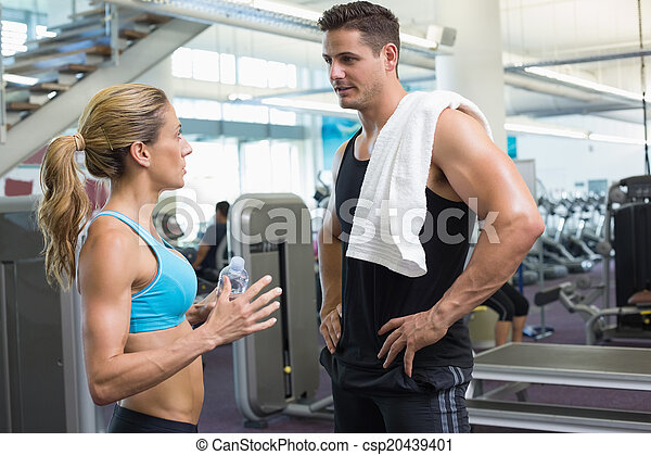 Bodybuilding man and woman talking together - csp20439401