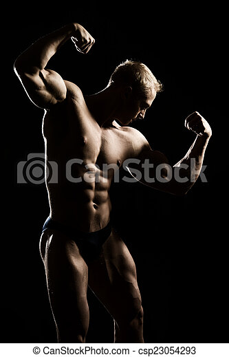 Handsome Muscular Athletic Man Posing Over Black Background
