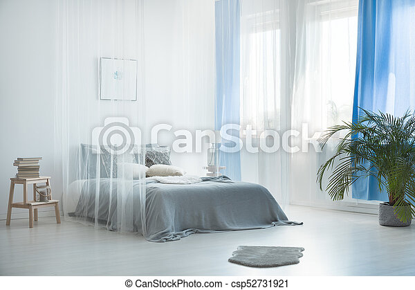 Bohemian loft with bed canopy - csp52731921