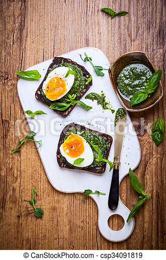 Boiled egg with pesto on toast - csp34091819