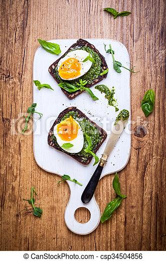 Boiled egg with pesto on toast - csp34504856