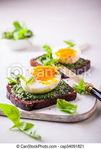 Boiled egg with pesto on toast - csp34091821