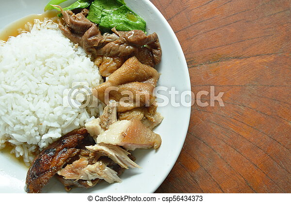 boiled pork leg in black Chinese herb soup slice with rice on plate - csp56434373
