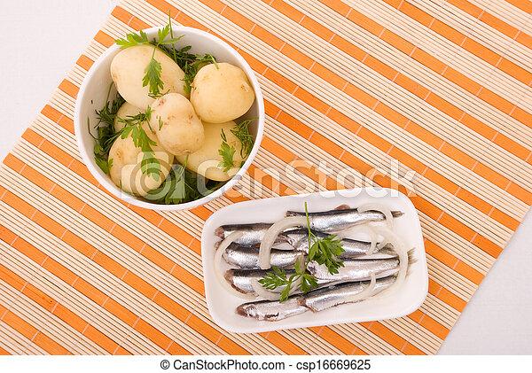 Boiled potatoes and salty fish - csp16669625