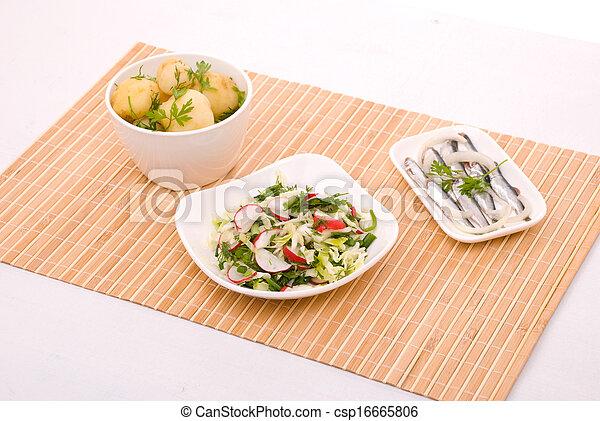 Boiled potatoes, salad and salty fish - csp16665806