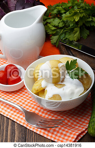 Boiled potatoes with parsley and sour cream - csp14381916