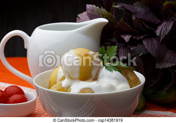 Boiled potatoes with parsley and sour cream - csp14381919